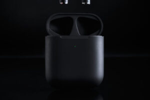 Set of black in ear headphones with black background
